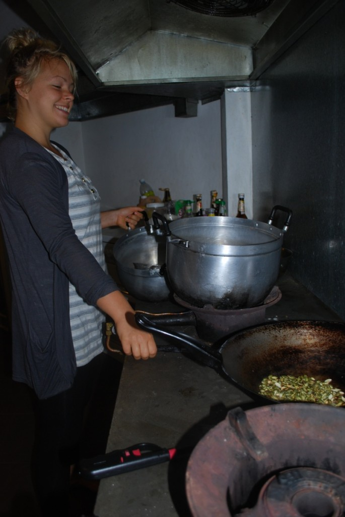 A Foundie preparing food with a smile